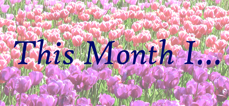 Red and pink tulip photograph with text 'This Month I...' on top in dark blue cursive